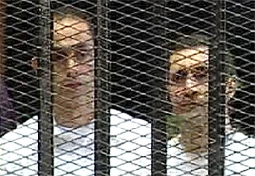 Gamal and Alaa Mubarak in the courtroom during their trial at the police academy in Cairo