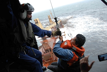 Coast Gaurd official airlifts a crewmember