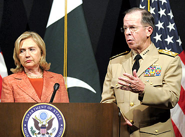 Admiral Mike Mullen with Secretary of State Hillary Clinton at the US embassy in Islamabad