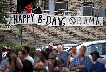 A banner wishes U S President Barack Obama a happy birthday outside of the Aragon Entertainment Center in Chicago