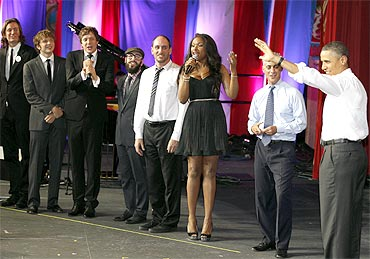 Obama (R) listens as performers, including Jennifer Hudson (3rd R), sing Happy Birthday to him