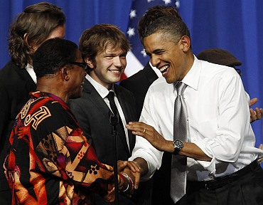 Obama is greeted by musician Herbie Hancock