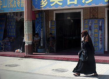 An Uighur ethnic woman at a market area in tense Kashgar, in Xinjiang province on August 2.
