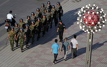Chinese police officers are deployed at a square in Kashgar following violence