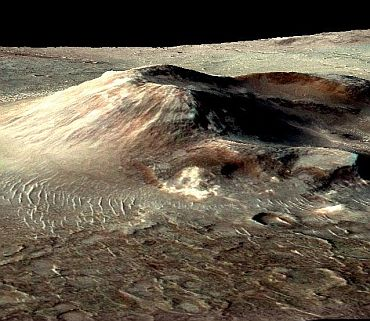 This volcanic cone in the Nili Patera caldera on Mars has hydrothermal mineral deposits on the southern flanks and nearby terrains. The deposits are evidence for a past local environment that was warm and wet or steamy, possibly hospitable to microbial life