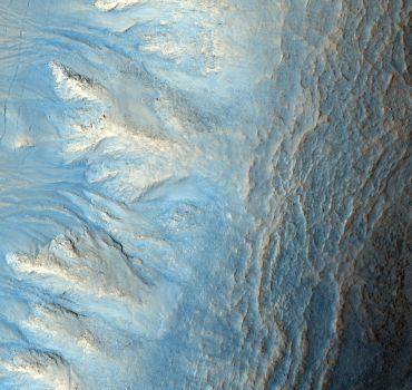 This image shows the west-facing side of an impact crater in the mid-latitudes of Mars' northern hemisphere