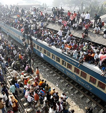 An overcrowded train leaves Dhaka's Airport rail station
