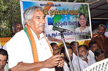 Chandy addressing a campaign rally before the state elections