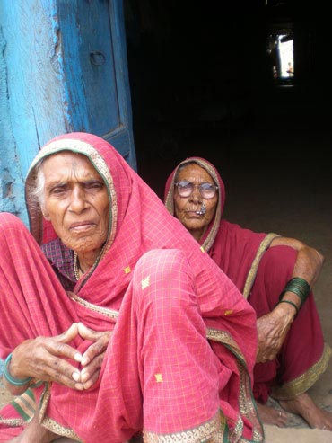 Elderly women listen to an election speech in Maharashtra