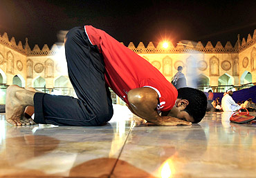 A Muslim man attends an evening prayer called Tarawih in Cairo