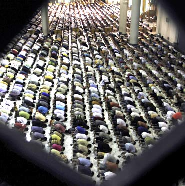 Muslim women attend mass prayer session Tarawih at Al Akbar mosque in Surabaya, East Java, Indonesia