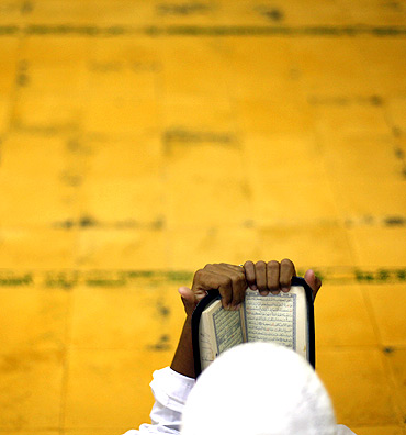 A student reads the Koran before morning prayer at the Al-Mukmin Islamic boarding school in Solo, Indonesia