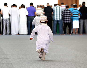 A young boy runs to take part in a prayer at Strasbourg's new Grand Mosque