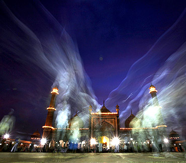 Muslims leave after their Iftar (fast-breaking) meal at the Jama Masjid in Old Delhi