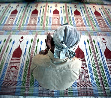 A Nepalese Muslim prays in Kathmandu