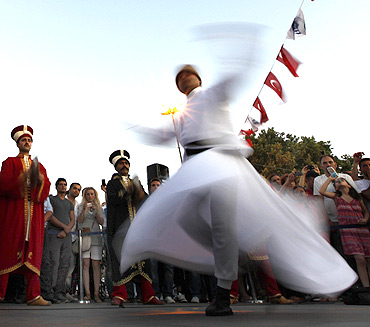 A whirling dervish performs before Iftar in Istanbul
