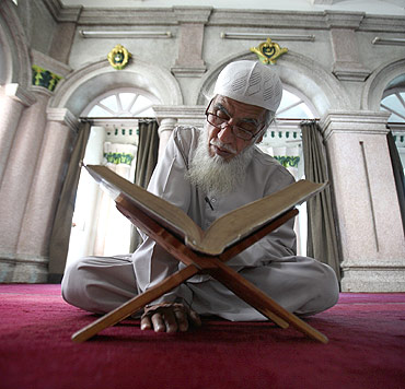 A Nepalese Muslim reads the Quran in Kathmandu