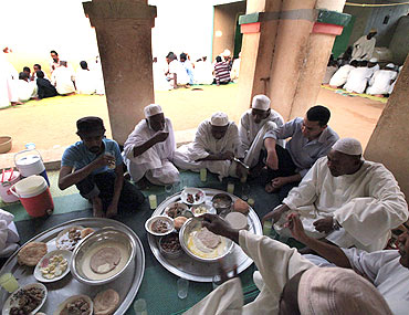 Men break their fast in a mosque at Umdowan Ban village outside Khartoum, Sudan