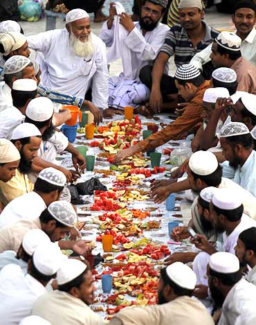 Muslims eat Iftar at a mosque in Ahmedabad