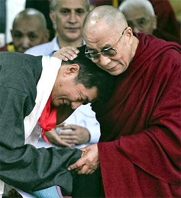 The Dalai Lama embraces Lobsang Sangay after his swearing-in ceremony in the Tsuglakhang temple in Dharamsala on Monday