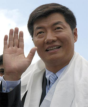 Lobsang Sangay waves to his supporters