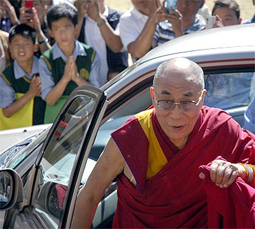 Children greet the Dalai Lama in Dharamsala