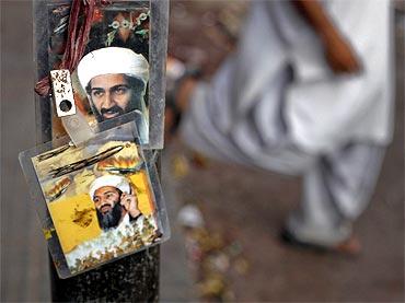 Images of Al Qaeda leader Osama bin Laden are displayed for sale at a roadside shop in Karachi