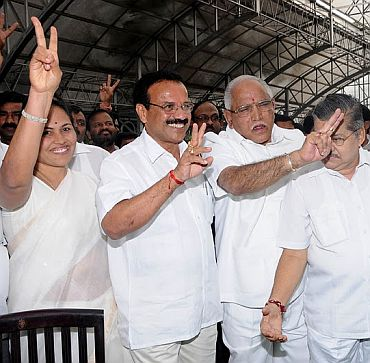 New Chief Minister Sadananda Gowda with Yeddyurappa and Shobha Karandlage