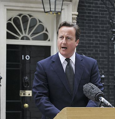 Britain's Prime Minister David Cameron speaks to the media
