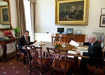 President Barack Obama has lunch with former Defence Secretary Robert Gates in the Oval Office Private Dining Room