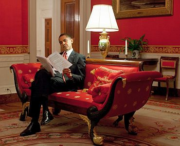 President Obama goes over notes in the Red Room