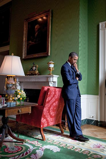 President Obama waits in the Green Room before being introduced at the White House Summit on Community Colleges