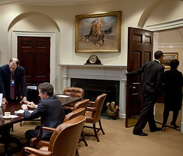 President Obama and Senior Advisor Valerie Jarrett depart the Roosevelt Room
