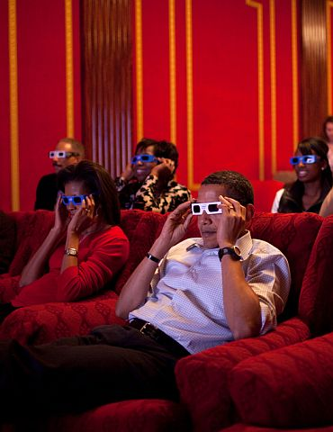 President Barack Obama and First Lady Michelle Obama wear 3-D glasses while watching a TV commercial during Super Bowl 43, Arizona Cardinals vs Pittsburgh Steelers, in the family theatre