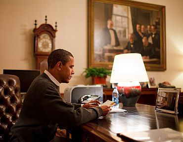 President Barack Obama sits at his desk in the Treaty Room Office