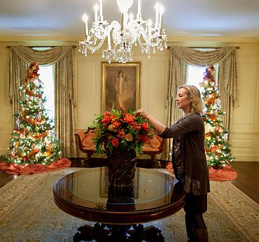 Chief Floral Designer Laura Dowling arranges a bouquet in the Vermeil Room of the White House