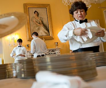 Residence staff prepare for the State Dinner in the Old Family Dining Room of the White House