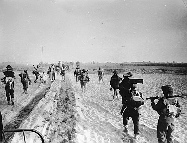 Indian troops advancing into the East Pakistan (Bangladesh) area during the Indo-Pakistani war