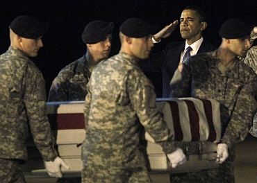 US President Barack Obama participates in the dignified transfer of Army Sgt Dale R Griffin at Dover Air Force Base, Delaware