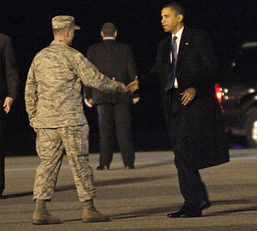 Obama is greeted by Air Force Col Manson Morris as he steps off Marine One at Dover Air Force Base