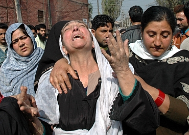 A Kashmiri relative cries during a protest against the conviction of Nazir Ahmad and his son Farooq Ahmad on October 26, 2005