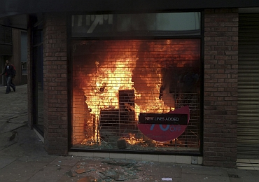 A clothing store is seen ablaze in Manchester city centre, northern England