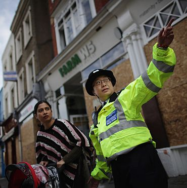 A police officer offers directions to a woman