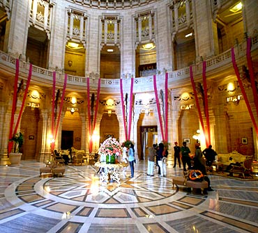 Guests walk through the lobby of Umaid Bhawan Palace, also a Taj hotel, in Jodhpur