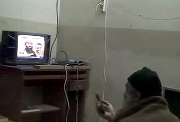 Osama bin Laden is shown watching himself on television, with US President Barack Obama also on screen, in this video frame grab released Pentagon