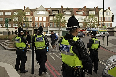 Police officers from Wales patrol in Streatham, south London