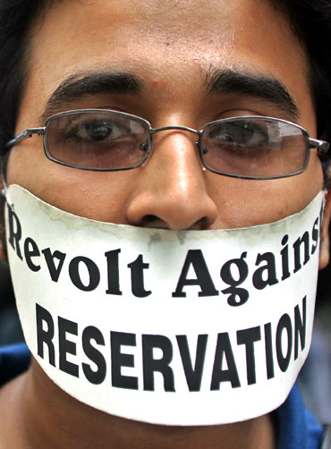 A medical student with an anti-reservation poster during a protest in a Kolkata hospital