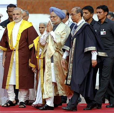 A file photo of Prime Minister Manmohan Singh with Gujarat Chief Minister Narendra Modi