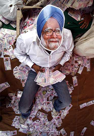 A BJP activist wears a mask depicting Prime Minister Manmohan Singh during an anti-government protest