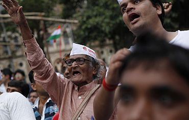 Supporters of Anna Hazare shout slogans at a rally against corruption in Mumbai